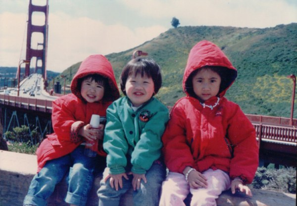Left to right: young Isabelle, family friend, and sister