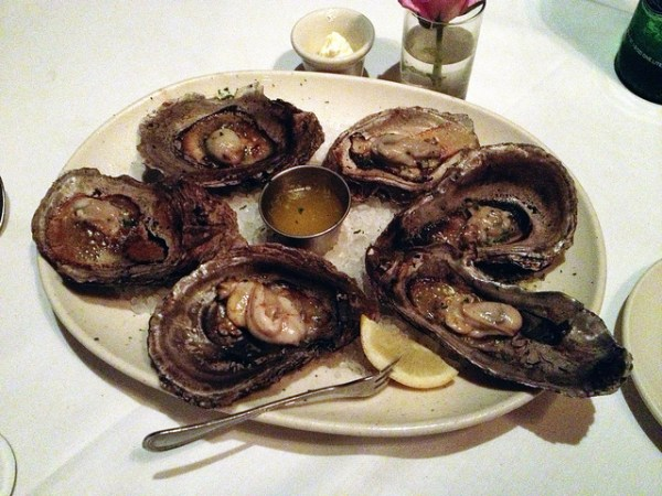 Smoked sizzling oysters. The shells are heated to 700 degrees separately and smokes the fresh oysters while being served.
