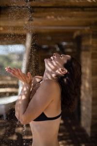smiling woman taking shower