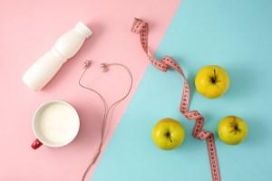 the green apple and bottle of yogurt