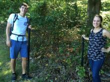 Interns Rob and Sarah at the site of a proposed sign.