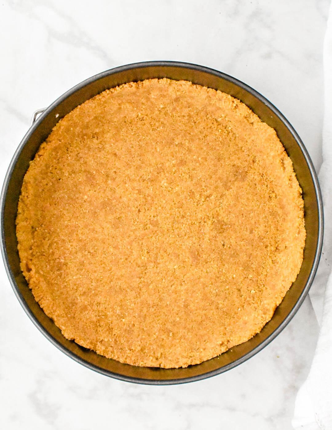 Graham crust pressed into springform pan