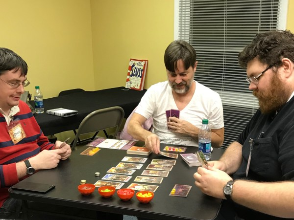 Brent, Tim and Larry playing Century: Spice Road in Gate Room