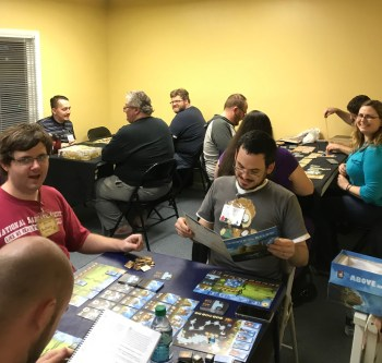 Several games going in the Dragon Room on Game Night