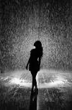 Silhouette of woman in rain