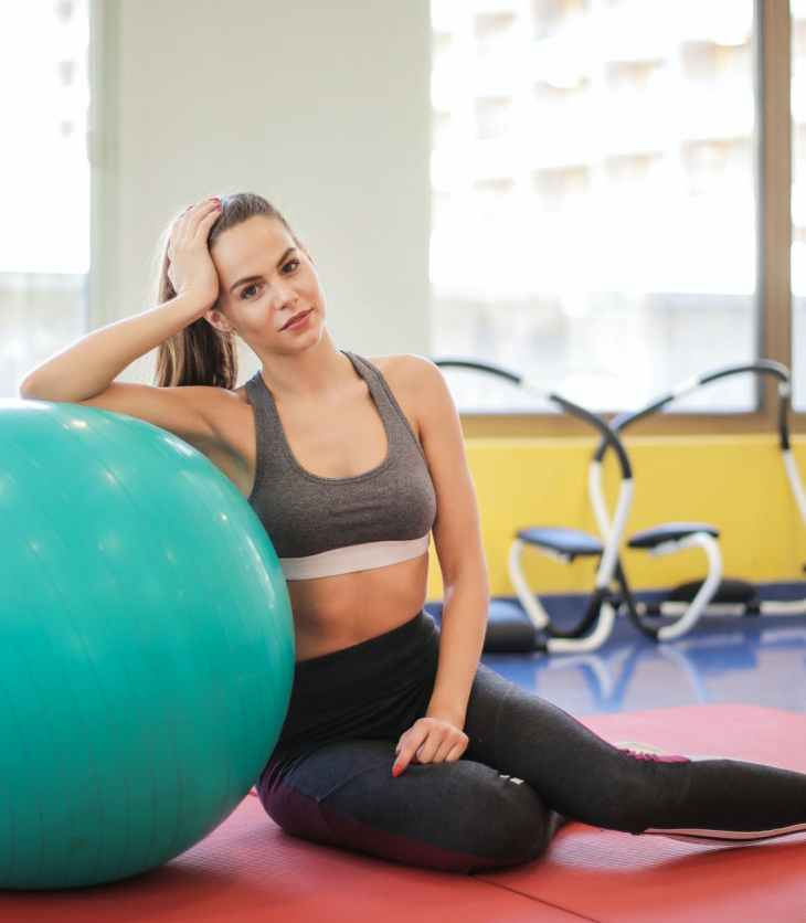 Woman relaxing on exercise ball