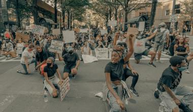 People protesting in street