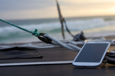 smartphone on dock at sunset