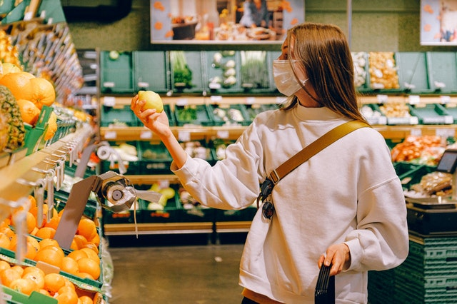 woman with face mask shopping