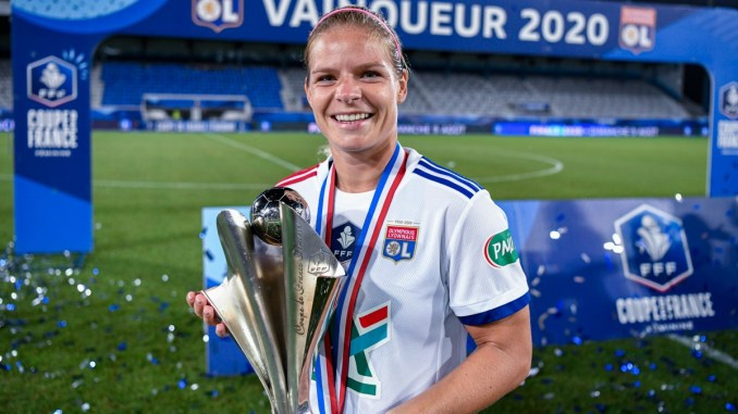 Eugenie Le Sommer holds the Coupe de France trophy.