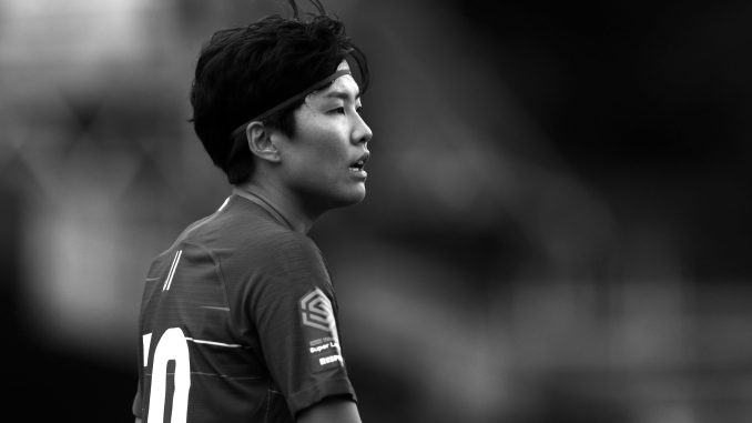 Black and white photo of Ji So-yun playing for Chelsea.