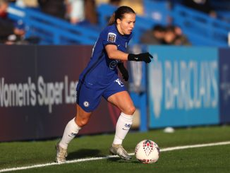 Fran Kirby of Chelsea runs with the ball.