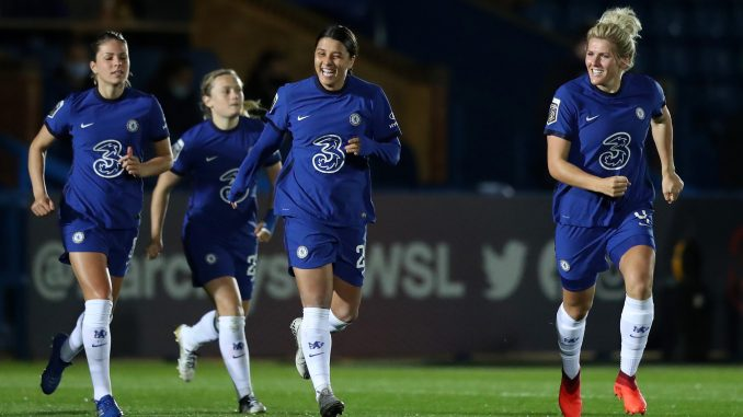 Chelsea's Sam Kerr and Millie Bright run onto the pitch.