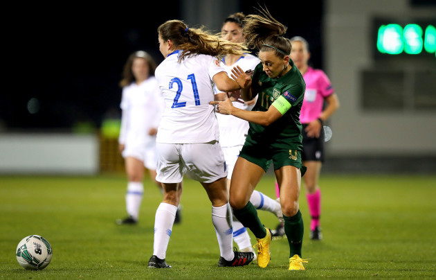 Despoina Chatzinikolaou of Greece and Katie McCabe of the Republic of Ireland challenge for the ball.