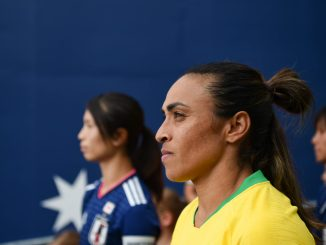 Aya Sameshima of Japan and Marta of Brazil lead their teams through the stadium tunnel.