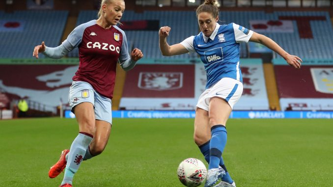 Stine Larsen of Aston Villa and Rebecca Holloway of Birmingham challenge for the ball.