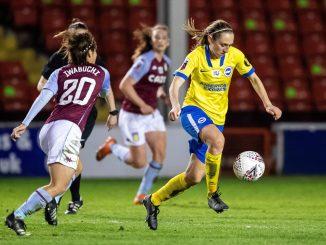 Brighton's Megan Connolly dribbles the ball.