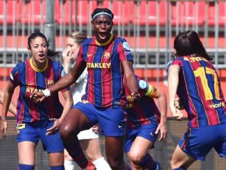 Barcelona's Asisat Oshoala celebrates scoring against Manchester City.