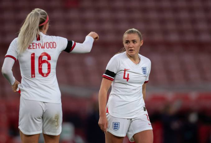 England's Georgia Stanway receives instructions from teammate Alex Greenwood.