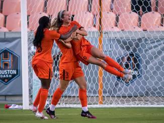 Houston Dash midfielder Shea Groom celebrates a goal.