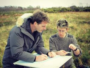 Dan Snow and Wayne Cocroft, from English Heritage, note the coordinates of the practice battlefield