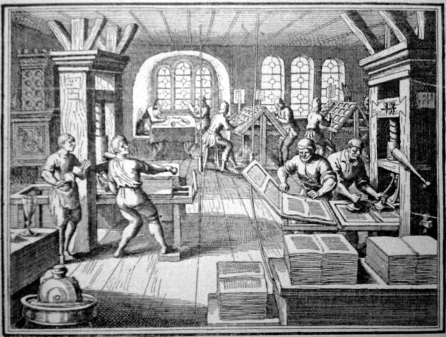 An etching of a 16th century printing press © Wikimedia Commons license