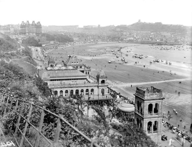 Scarborough in the late 19th century with the recently rebuilt Spa in the foreground and the Grand Hotel on the left. On the beach bathing machines were still in use. CC76/00420