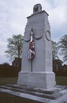 The Royal Berkshire Regiment decided from the outset that their memorial, sited outside the regimental barracks, should be a copy of the Cenotaph, abeit reduced in size. Lutyens agreed and made minor changes such as adding an urn on top and painted stone flags on either side. He had designed stone flags for the original Cenotaph, but they had been rejected. This cenotaph is the only one in England that bore them. It was unveiled by the Regiment's colonel on 13 September 1921 when a roll of honour carrying the names of the dead was placed within the memorial. Photo courtesy of Tim Skelton
