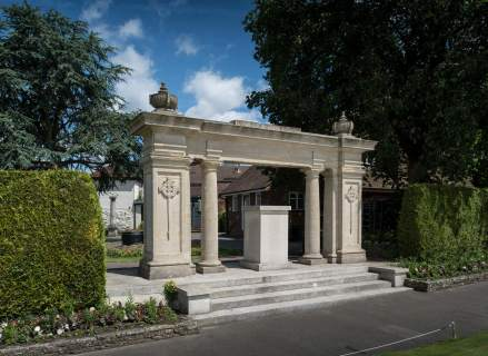 Guildford War Memorial, Surrey. Unveiled 6 November 1921. Newly listed at Grade II. © Historic England DP182722. This imposing Classical screen, made of Portland stone and supported on massive square pillars, stands in Guildford Castle gardens. It is ornamented with carved commemorative symbols of reversed swords and wreaths, and honours the 440 local servicemen who died in the First World War. Their names are recorded on stone panels.