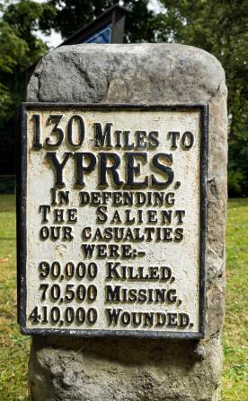 Ypres Memorial Milestone, Christ Church, Shooter's Hill, Royal Borough of Greenwich. Listed Grade II (list entry updated). © Historic England DP182715. This is an unique example of an 18th century milestone being adapted with a plaque that marks the fallen of the Ypres Salient offensive - the Third Battle of Ypres (Passchendaele). The milestone also shows how far it is to Ypres Cloth Hall, Belgium which was destroyed during the first World War. In 1922, the milestone was moved from the roadside opposite Christ Church to its current location in the churchyard. The plaque was added at that date in order to perform a commemorative function. The current plaque is a replacement for the one that was stolen.