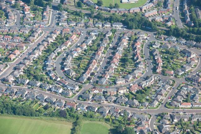 An aerial image of a leafy suburban area laid out in the shape of a trident
