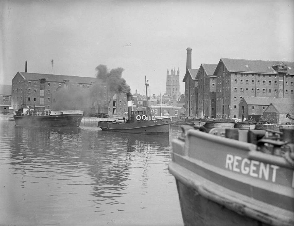 Steam boats moored at Gloucester docks c 1925 c Historic England AA53_10346