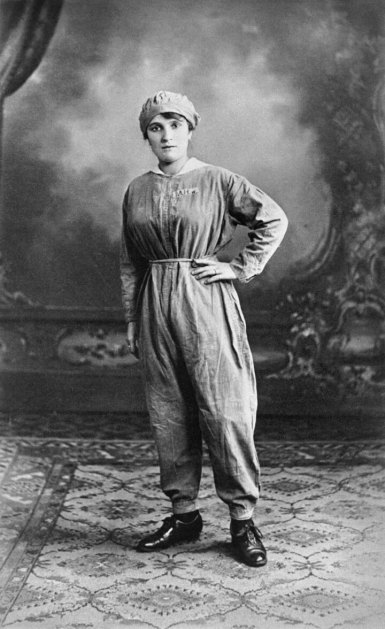 Portait of a woman munitions worker in protective clothing