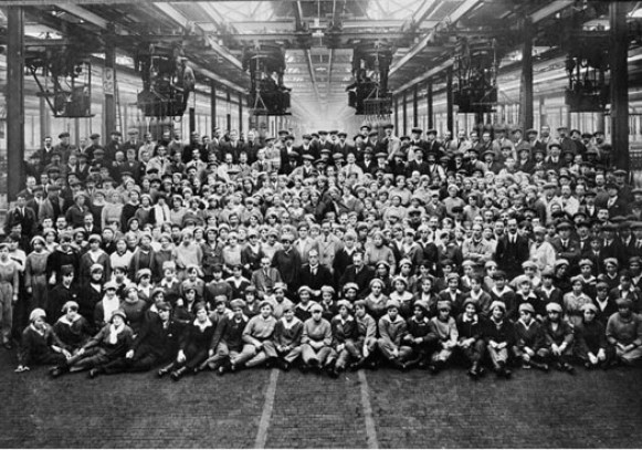 A group portrait of mostly women factory workers