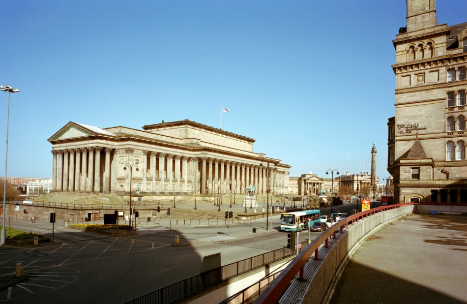 St George's Hall in Liverpool with the road and a bus in the foreground