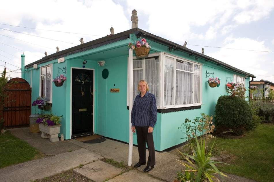 Jim Blackender stood in front of his prefab on the Excalibur Estate
