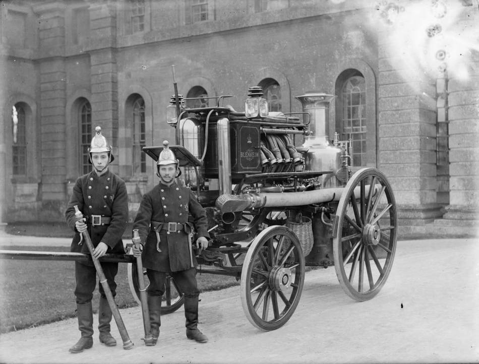 Fire engine with two men in the foreground. Blenheim, Oxfordshire