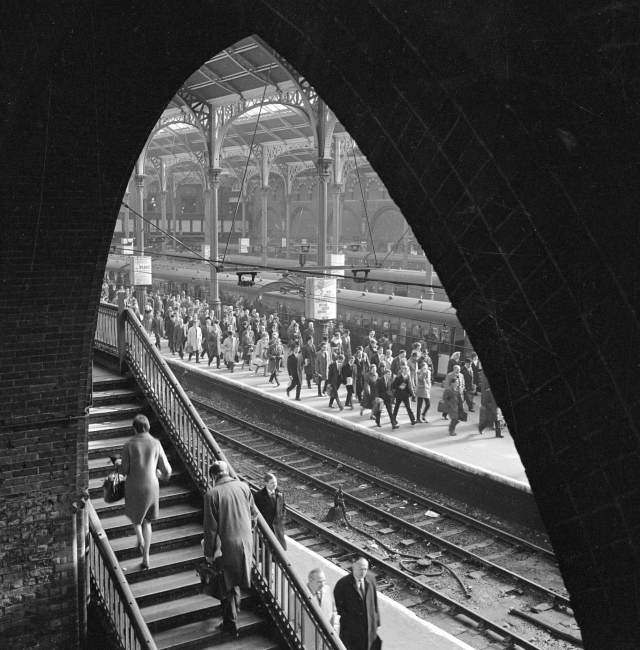 Crowds of commuters leaving platforms at Liverpool Street Station, 1960-1972