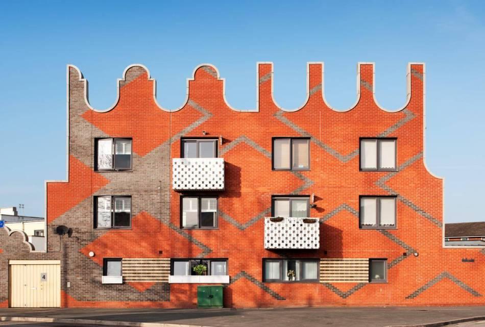 The bright orange exterior of Islington Square, Manchester