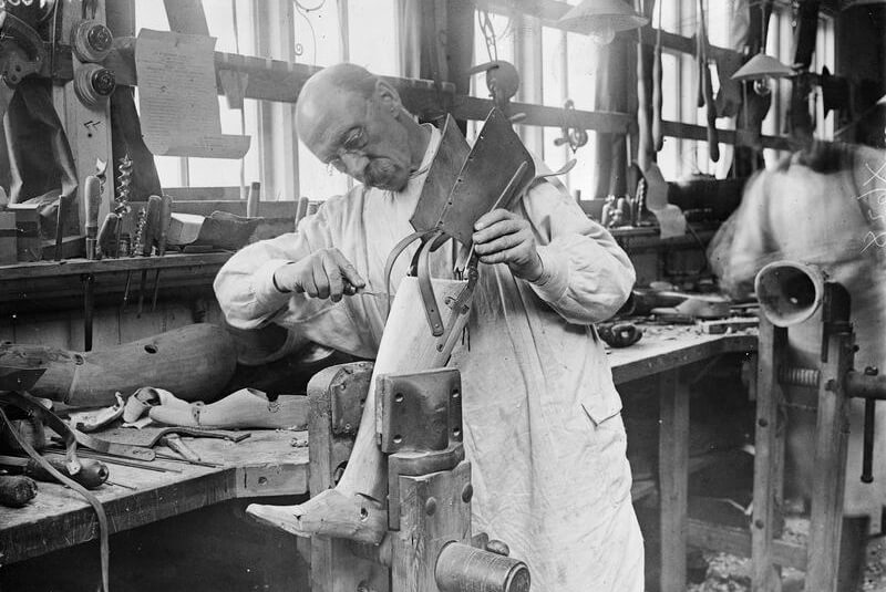 A craftsman making an artificial leg for a wounded soldier at Queen Mary's Hospital