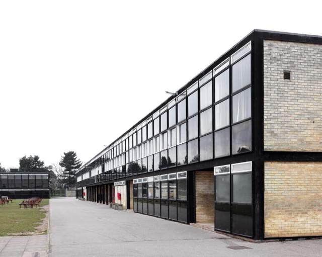 Exterior of Smithdon School glass frontage facing a paved area