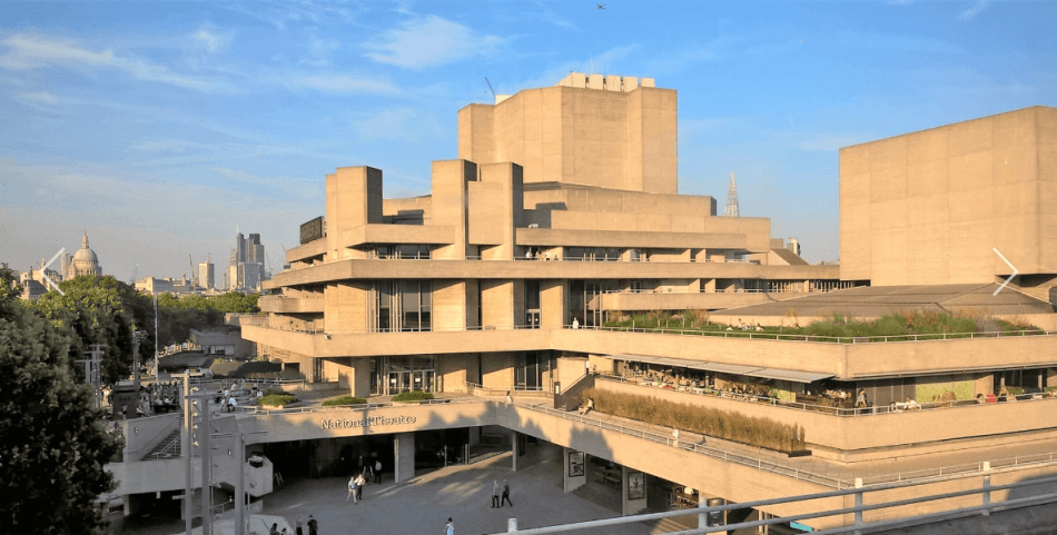 The National Theatre bathed in sunlight, St Paul's Cathedral can be seen in the background
