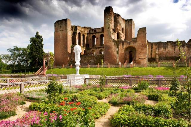 Exterior of Kenilworth Castle, with view of the gardens