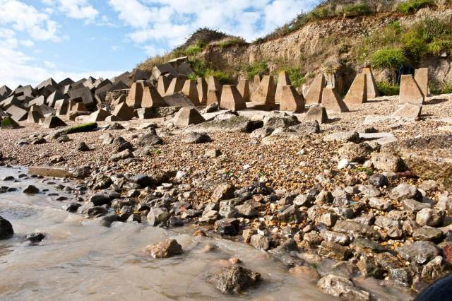 Anti-tank obstacles - carved geometric stones - on a beach