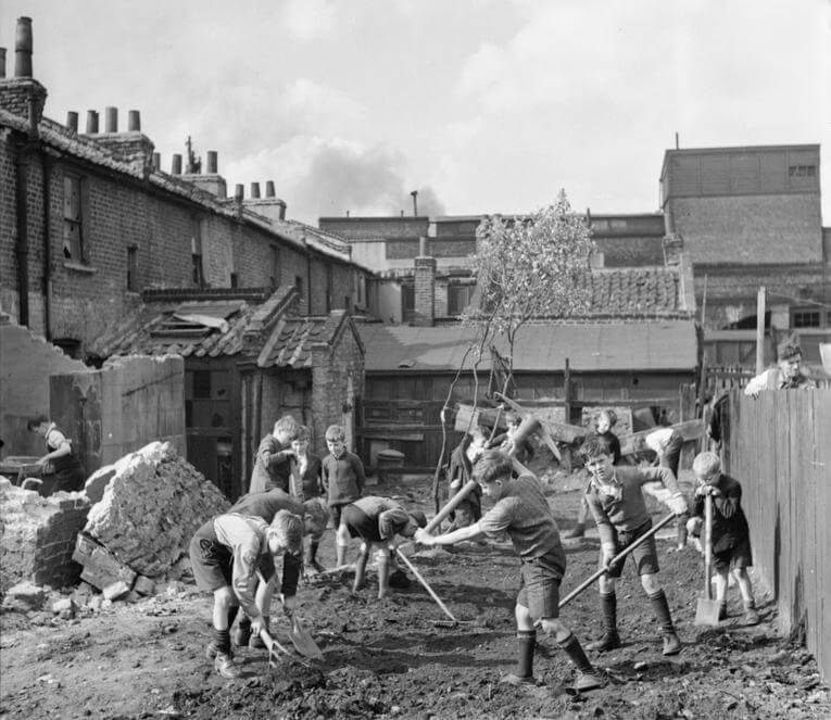 Young boys start to create an allotment on a bomb site
