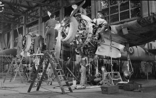 WAAF flight mechanics and Royal Air Force (RAF) mechanics work together on a Bristol Beaufighter Mark VI plane at the Operational Training Unit, Cranfield