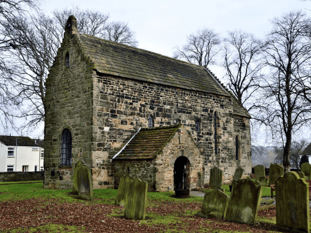 Side on view of Escomb Church, including graveyard