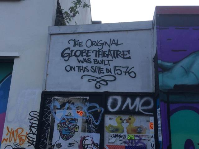 Graffiti on New inn Broadway reading 'The original Globe theatre was built on this site in 1576)