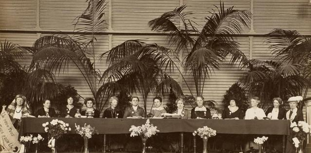 International Congress of Women in 1915. From left to right: 1. Lucy Thoumaian - Armenia, 2. Leopoldine Kulka, 3. Laura Hughes - Canada, 4. Rosika Schwimmer - Hungary, 5. Anika Augspurg - Germany, 6. Jane Addams - USA, 7. Eugenie Hanner, 8. Aletta Jacobs - Netherlands, 9. Chrystal Macmillan - UK, 10. Rosa Genoni - Italy, 11. Anna Kleman - Sweden, 12. Thora Daugaard - Denmark, 13. Louise Keilhau - Norway. Image courtesy LSE Library