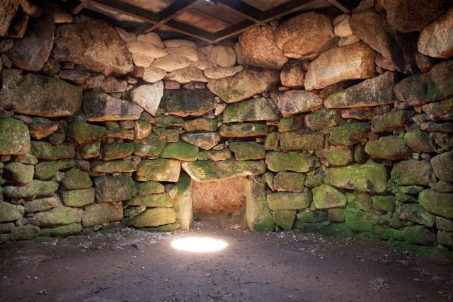 Inside the round chamber towards the fogou at Carn Euny Ancient Village, Sancreed, Penzance, Cornwall © Historic England Archive